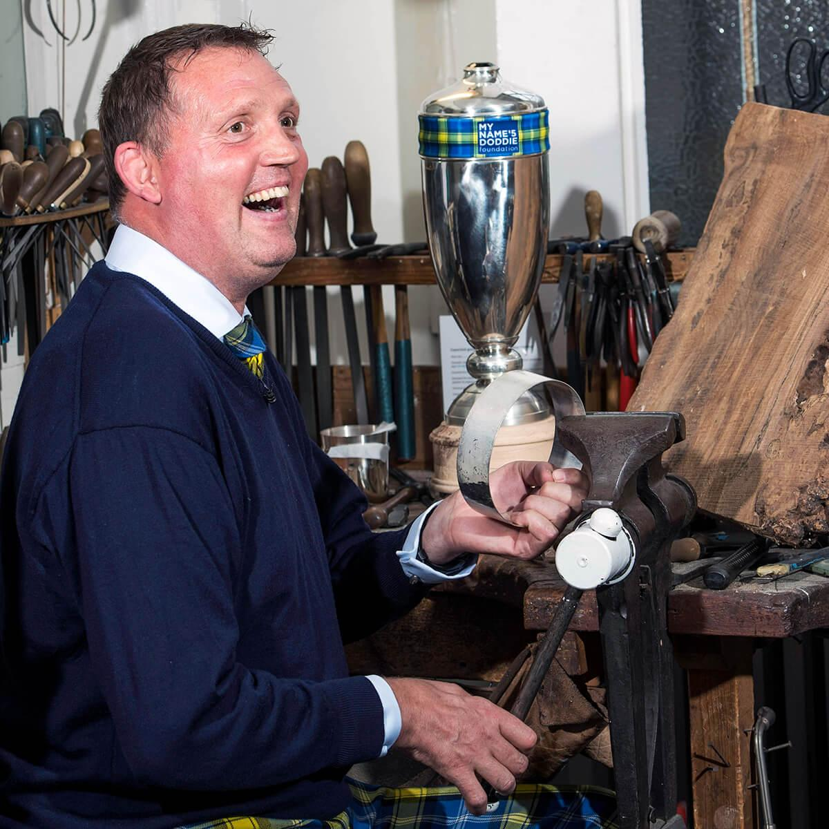 Doddie Weir helps to finish making the Doddie Weir Cup